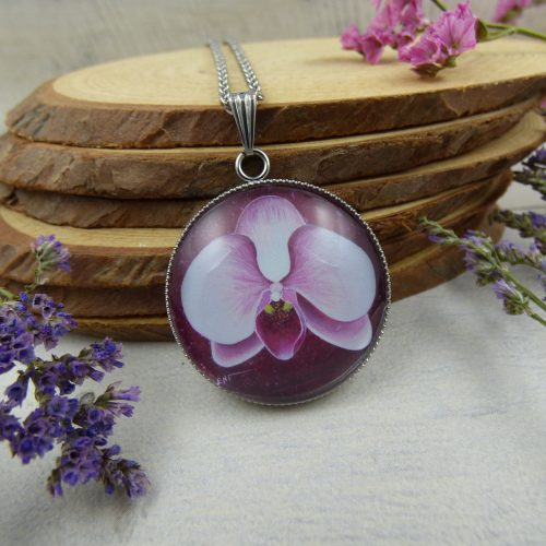 médaillon avec fleur d'orchidee rose