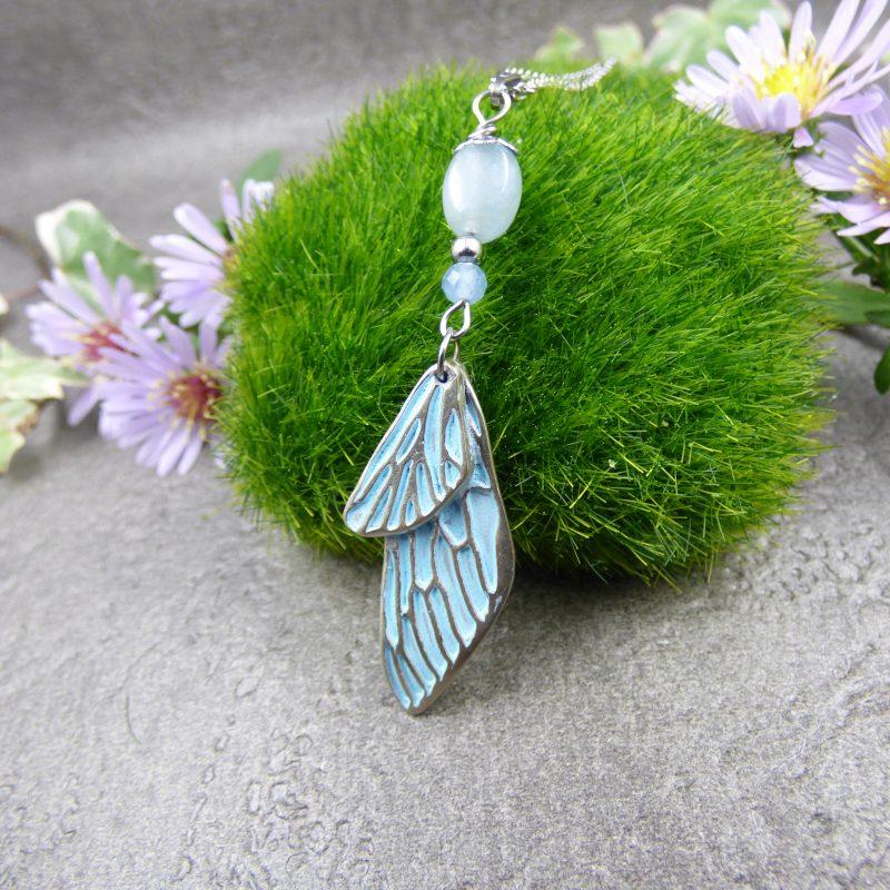 bijou avec ailes de papillon en bronze